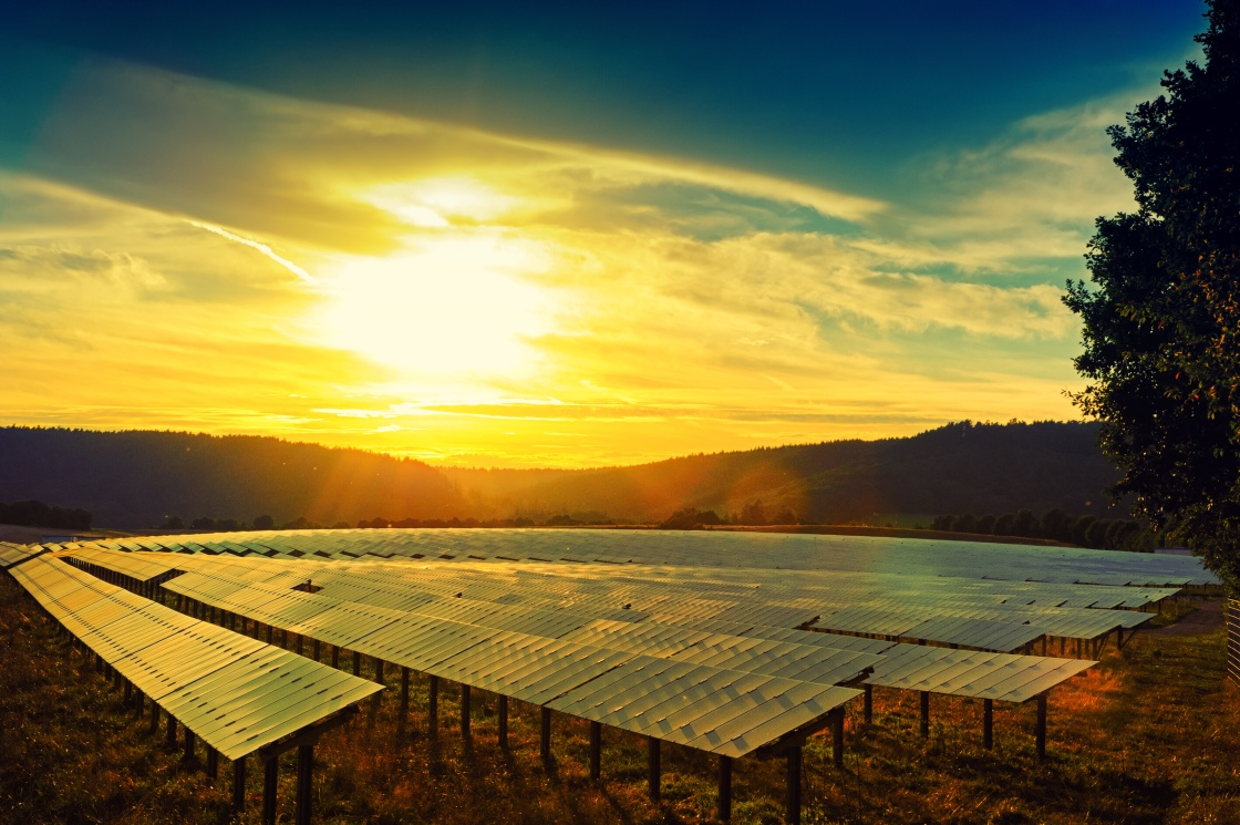 Beautiful sunset over solar energy field